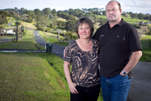 Andrew and Christine Segar have been stung with a huge rates rise for their Long Bay property. Photo / Natalie Slade 