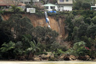 The slip in Matua swept tonnes of earth and uprooted trees towards the estuary below. Photo / Alan Gibson