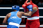 Mohammed Arjaoui of Morocco competes against Blaise Yepmou Mendouo of Cameroon. Photo / AP