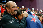 Coach Jean-Pierre Egger comforts Valerie Adams. Photo / Matt Dunham
