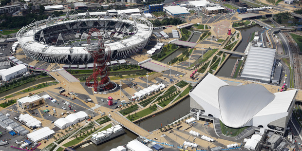 The London 2012 Olympic Park. The Olympic stadium and Accor Mittal 'Orbit' Tower (left), and the Aquatic Centre and Water Polo pool (right). Photo / AP