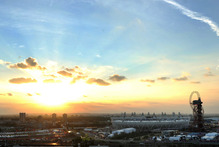 The sun sets behind the Olympic stadium before the Closing Ceremony of the 2012 Summer Olympics. Photo / AP