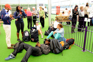 US sprinter Justin Gatlin relaxes as he waits to depart at the Games Terminal at Heathrow Airport. Photo / AP