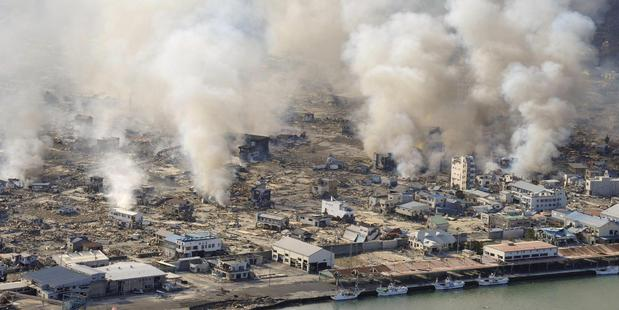 This March 12, 2011 file photo shows smokes rising from burning homes in Yamadamachi in Iwate Prefecture, northern Japan a day after a strong earthquake triggered a devastating tsunami. Photo / AP