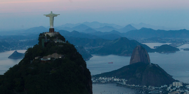 Today Rio de Janeiro picks up the baton with its famous landmarks as Brazil's second largest city receives the Olympic flame.  Photo / AP