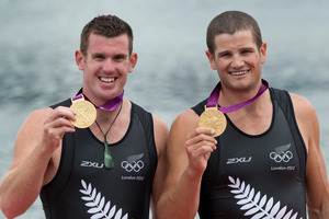 New Zealand Double Scull pair of Nathan Cohen and Joseph Sullivan with their Gold Medals. Photo / Brett Phibbs