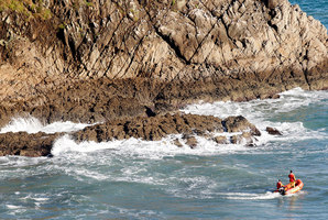 Divers searching for the bodies of the people, who were swept off Paritutu Rock in New Plymouth. Photo / Christine Cornege