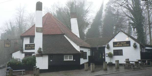 Ye Olde Fighting Cocks provides warmth and sustenance on a foggy day in St Albans. It may possibly be the oldest pub in Britain, with parts of the building dating back to 795. Photo / Jim Eagles