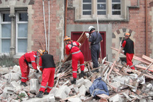 Workers clean up Christchurch Girls High School after an earthquake. Photo / The Daily Post
