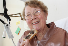 Solveig Sheed having Marmite on toast for breakfast at Nelson Hospital. Photo / Andrew Board
