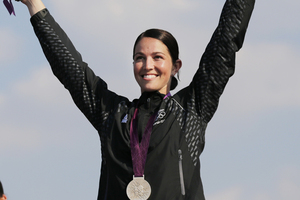 Sarah Walker celebrates her gold medal. Photo / AP