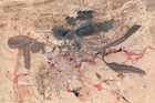 A rare earth metal mine in Bayan Obo, Inner Mongolia.  120km south of here, the processing town of Baotou has suffered ecological devastation. Photo /  2006 false color ASTER image by NASA