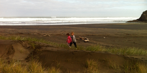 Danielle Wright's children explore uninterrupted on an empty Anawhata Beach. Photo / Supplied