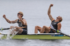 Hamish Bond and Eric Murray celebrate after winning gold in the final of the men's pair. Photo / Brett Phibbs
