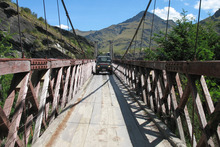 The Skippers Canyon Suspension Bridge is a tight squeeze for the Land Rover. Photo / Paul Rush