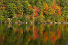Autumn colours are reflected in Gatineau Park's Meech Lake. Photo / Thinkstock