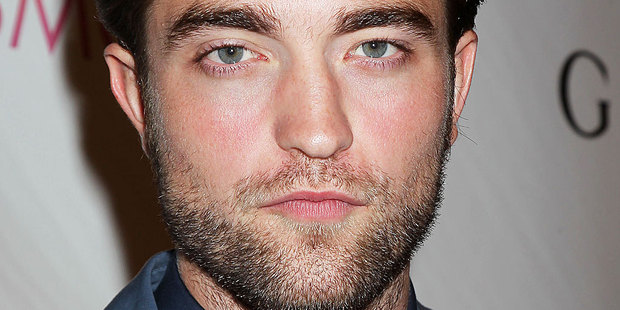 Robert Pattinson evaded questions about his girlfriend's affair during an interview on Good Morning America. Photo / AP