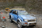 The Toyota Hilux in which a 10-year-old boy drowned after it landed upside down in the mine pond. Photo / Greymouth Star
