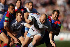 Glenn Stewart of the Sea Eagles charges towards the line to score a try against the Knights. Photo / Getty Images