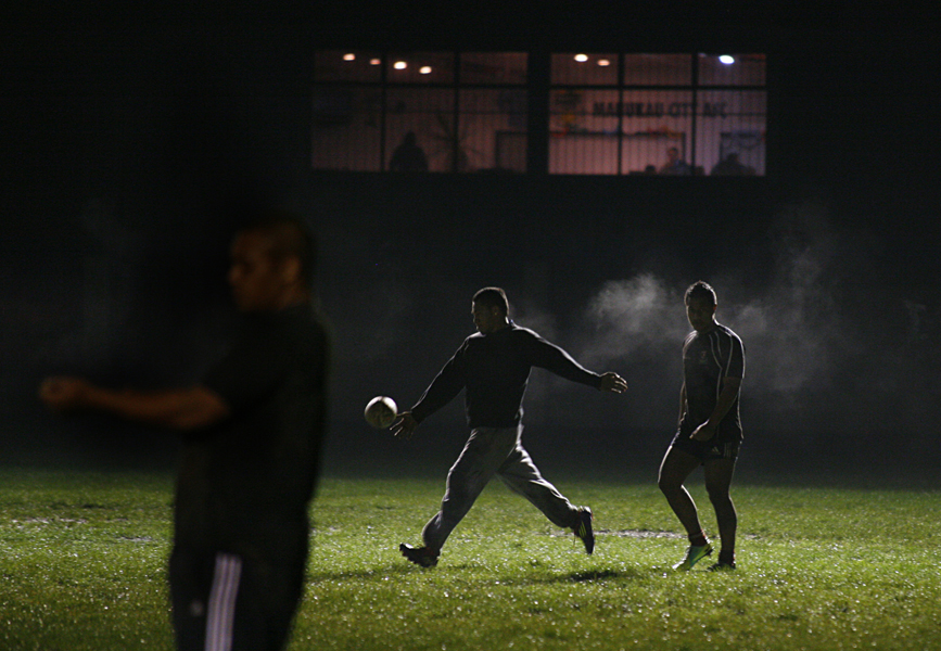 Mangere East Hawks players during training on a wet winter's night