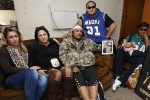 Members of the Dunn whanau, including occupants James, second from right and Raymond Dunn, right, in the Otangarei home the two brothers face eviction from. Photo / Northern Advocate
