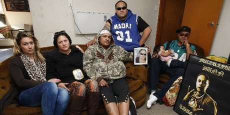 Members of the Dunn whanau, including occupants James, second from right and Raymond Dunn, right, in the Otangarei home. Photo / Northern Advocate
