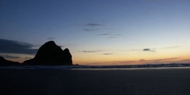 Piha after sunset. Photo / Wikimedia Commons