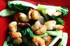 Lighthouse Gin scallops with baby bok choy. Photo / Doug Sherring