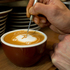 Barista Sean Kim does art while making your morning latte. Photo / Kellie Blizard