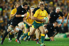 Will Genia (right) of the Wallabies in action last night. Photo / Getty Images