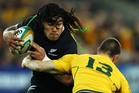 All Black centre Ma'a Nonu takes on his opposite Rob Horne in the Bledisloe Cup match against Australia in Sydney. Photo / Getty Images
