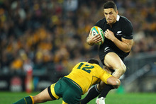Midfielder Sonny Bill Williams brushes off would-be Aussie defenders in what may have been his last test for the All Blacks at Eden Park on Saturday night. Photo / Getty Images