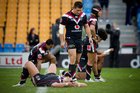 Warriors players can't hide the disappointment of another loss. Photo / Greg Bowker