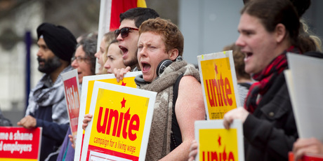 Unite supporters protest outside Burger King at Aotea Square yesterday. They say staff of the fast-food chain are pressured not to join the union. Photo / Natalie Slade