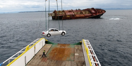 The Mercedes C200 Kompressor being recovered from the Rena.  Photo / APN