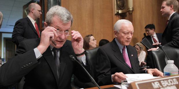 Max Baucus (left) is chairman of the US Senate finance committee. Photo / AP