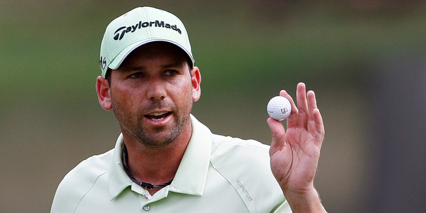 Sergio Garcia waves to the crowd following a putt on the 15th green. Photo / AP