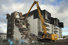 Demolition of the earthquake damaged Water's Edge Apartments on Tidal View Road, Ferrymead. Photo / File