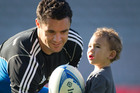 Nineteen-month-old Zac Stanley plays with Daniel Carter at Eden Park. Photo / Richard Robinson