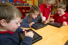 Four-year-olds (from left) Harry Ward, Alice Egerton, Emma Dickson and Ted Henderson all use iPads at the Kelburn Little School in Wellington. Photo / Marty Melville