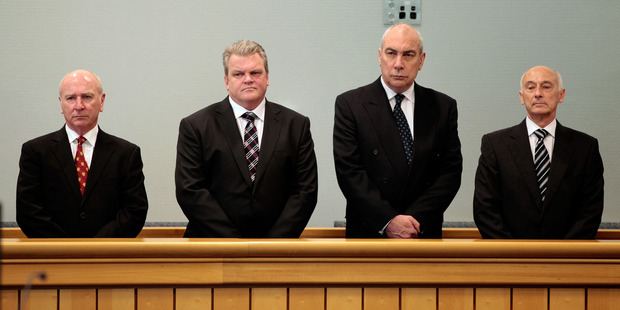 (L- R) Bridgecorp Rod Petricevic, Robert Roest, Gary Urwin and Peter Steigrad, stand in the dock at the Auckland High Court. Photo / Brett Phibbs