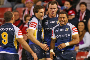 Matthew Bowen of the Cowboys is congratulated after scoring against the Dragons. Photo / Getty Images