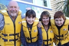 South New Brighton School Principal John Bockett, Rachel Anderson, Wendy McLintock and Jack Anderson sporting the lifejackets they will wear if they are hit by a tsunami.  Photo / Shelley Robinson