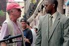 Tony Scott talks to actor Denzel Washington while filming his 2004 movie Man on Fire. Photo / 20th Century Fox