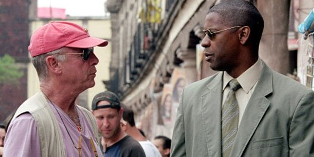 Tony Scott talks to actor Denzel Washington while filming his 2004 movie Man on Fire. Photo / 20th Century Fox