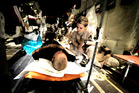 Senior Airman Libby See cares for a patient during an aeromedical evacuation mission to transport patients to Bagram Airfield, Afghanistan. Photo / US Air Force/Staff Sgt. Shawn Weismiller