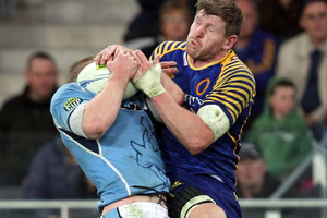 Adam Thomson of Otago and Cam Goodhue of Northland compete for the ball . Photo / Getty Images