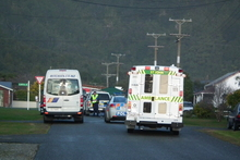 The scene in Hector today after a school bus (left) struck and killed a 5-year-old boy. Photo / Keira Stephenson