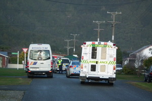 Police and paramedics at the scene where Mahuri Bettjeman-Manawatu was run over and killed by a school bus. Photo / Keira Stephenson