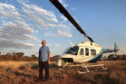 Australian businessman Dick Smith, seen here with his LongRanger helicopter in the Australian outback, is on a mission to change big business. Photo / Nick Graalman.